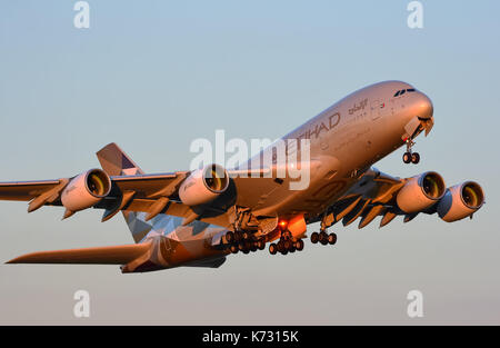 HEATHROW, LONDON, UK - JULY 2017: Etihad Airways Plane Airbus A380-861 taking off  at London's Heathrow Airport, - Stock Photo