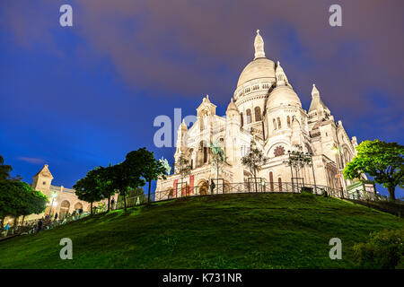 Sacre Coeur in Paris light up at Night - Stock Photo