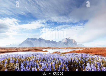 Picturesque views of the river and mountains in Iceland. - Stock Photo
