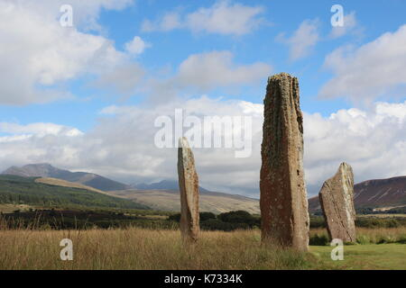Ancient Stone Circle On The Isle Of Arran, Scotland In Front Of Mountains - Stock Photo