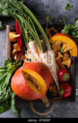 Variety of autumn harvest vegetables carrot, parsnip, chard, paprika, hokkaido pumpkin, porcini and chanterelles - Stock Photo