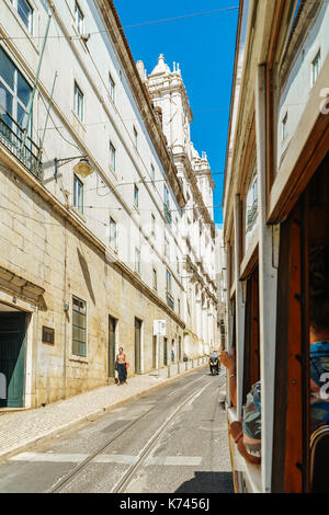 LISBON, PORTUGAL - AUGUST 09, 2017: Tourists Travel By Tram 28 In Downtown Lisbon City. - Stock Photo