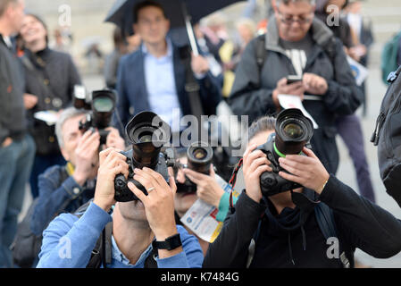Photographers covering an event in Trafalgar Square, London. Cameras. Lenses - Stock Photo