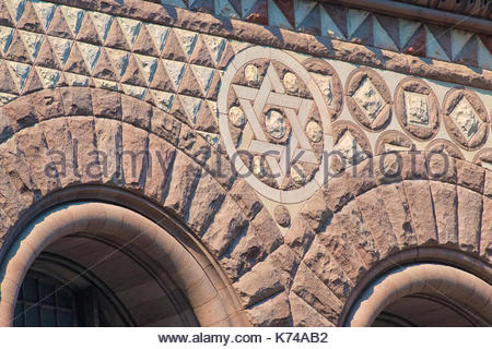 Old City Hall Richardsonian Romanesque Revival architectural details. David star and arches in the facade.  The - Stock Photo