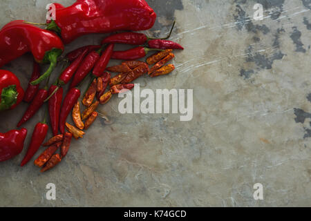 Overhead of red chilies, dried red chili pepper and capsicum - Stock Photo