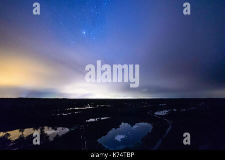 night sky with stars and milky way over beach - Stock Photo