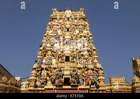 The complex Gopuram Tower of New Kathiresan Hindu Temple in Pettah district of Colombo, Sri Lanka. - Stock Photo