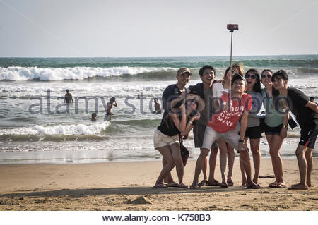 Group of Friend Take a Selfie on the Beach, West Java, Indonesia. - Stock Photo