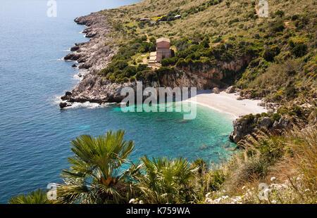 A beach called the Tonnarella dell'Uzzo in the Zingaro nature park in northern Sicily near the town of San Vito - Stock Photo