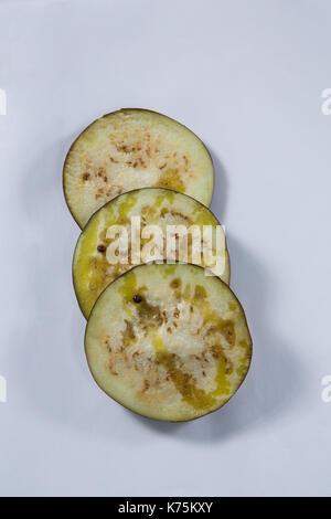 Slice of eggplants on white background Stock Photo