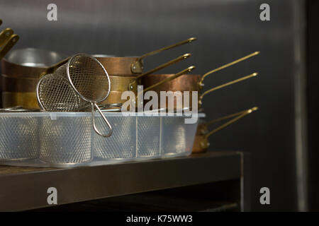 Close-up of kitchen utensils at restaurant - Stock Photo