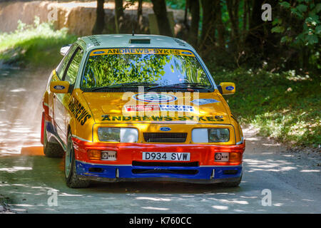 1986 Ford Sierra RS Cosworth rally car on the forest stage with driver Jason Lepley at the 2017 Goodwood Festival - Stock Photo