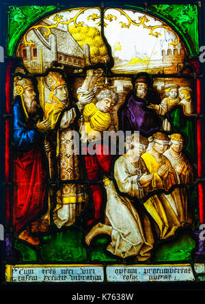 Stained glass panel made in South Netherlands, dated 1509-1603, depicting St Nicholas Preventing an Execution, exhibited - Stock Photo