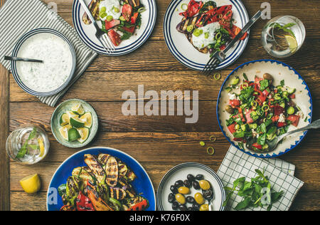 Flat-lay of healthy vegetarian dinner table setting - Stock Photo