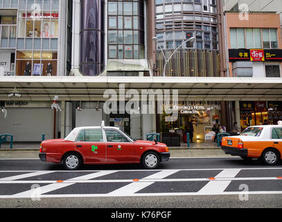 Kyoto, Japan - Nov 27, 2016. Taxis at downtown in Kyoto, Japan. Kyoto was the capital of Japan for over a millennium, - Stock Photo