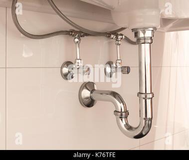 Basin siphon or sink drain in a bathroom, clean - Stock Photo