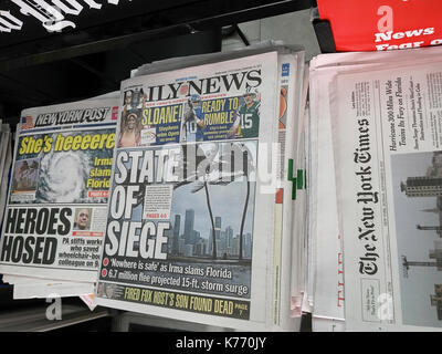 New York newspapers report on Sunday, September 10, 2017 on the effects of Hurricane Irma and its impending arrival - Stock Photo