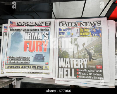 New York newspapers report on Monday, September 11, 2017 on the effects of Hurricane Irma and its arrival in Florida. - Stock Photo