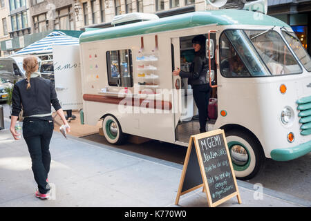 A customized ice cream truck is parked outside of a Pottery Barn grand opening promotes the M. Gemi brand of Italian - Stock Photo