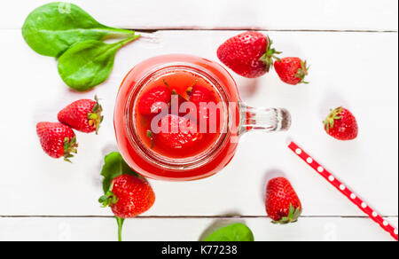 Strawberry smoothie or milkshake in a jar on white background, healthy food for breakfast and snack - Stock Photo