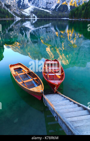 Braies lake and boats in the background of Seekofel mountain in Dolomites,Italy ( Pragser Wildsee ) - Stock Photo