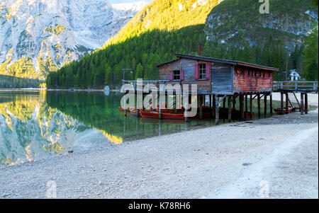 Braies lake and house in the background of Seekofel mountain in Dolomites,Italy ( Pragser Wildsee ) - Stock Photo