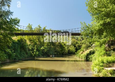 Bridge over the Petite Baïse River in the Dordogne region of southwest France. - Stock Photo