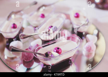 Beautiful multicolored decorated candy table baked sweet tasty cupcake cupcakes on a party with happy people around, - Stock Photo