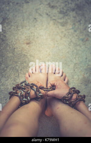 vintage tone of Shot focus of  hand of Woman  chained - Stock Photo