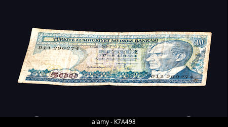 Old Turkish 500 liras banknote on a black background. - Stock Photo