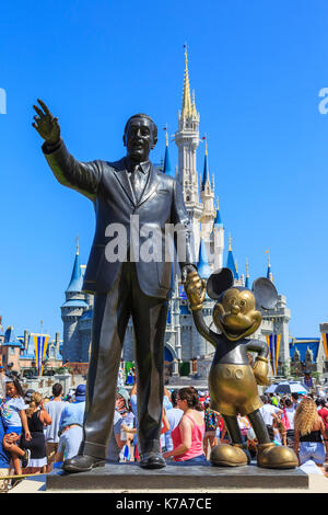 Iconic statue of Walt Disney holding hands with Mickey Mouse at The Magic Kingdom theme park, Orlando, Florida, - Stock Photo