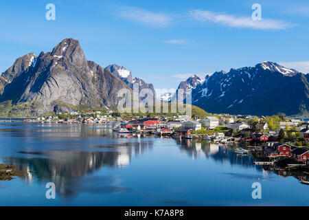 Reflections of mountains in scenic natural fishing harbour in summer. Reine, Moskenes, Moskenesøya Island, Lofoten - Stock Photo
