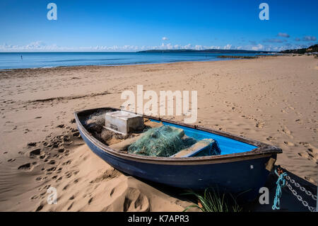 Fishing Boat on Branksome beach in Poole Bay, Dorset, England, UK. - Stock Photo