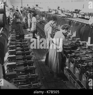1950s, historical, Irish weavers, female workers standing on wooden floorboards using mechanised linen looms, Northern - Stock Photo