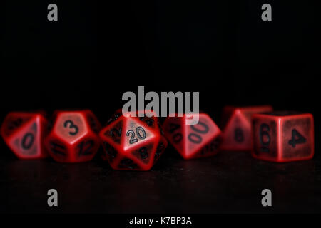 A set of polyhedral dice on a slate surface. These dice are used for role playing games such as Dungeons & Dragons. - Stock Photo