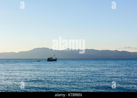 Fishing boat is in transport passing over sea going out for night fishing. - Stock Photo