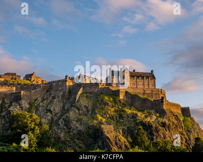 Sunset, Edinburgh Castle, viewed from Princes Street Gardens, Edinburgh Castle, Castle Rock, Edinburgh, Scotland. - Stock Photo