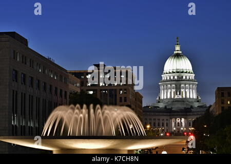 SEPTEMBER 12, 2017 - MADISON, WISCONSIN : The capital building dome in Madison, Wisconsin at night with the fountain - Stock Photo