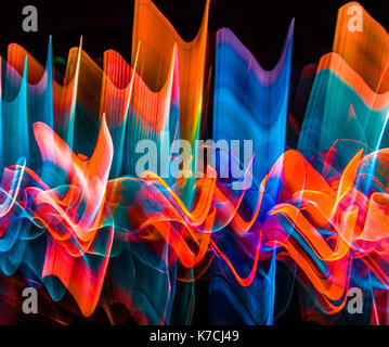 Abstract wavy and horizontal color lights in motion. - Stock Photo