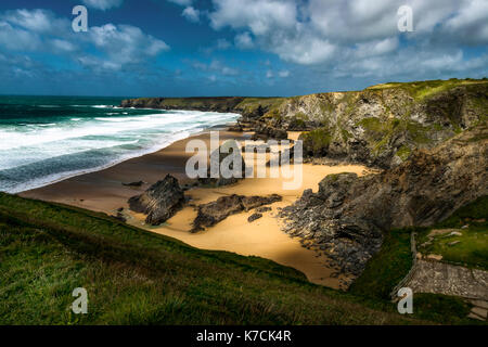 Bedruthen Steps, Cornwall, UK. The awe inspiring Bedruthen steps bathed in scultped light as day of high wind and - Stock Photo