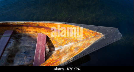 Dugout canoe floating in water. Traditional native american design. Top down close up view.
