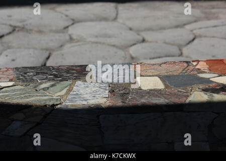 Pompei, Italy, August 9 2014: Caupona of Asellina tavern house in Pompei, bar's countertop with broken marblecolored - Stock Photo