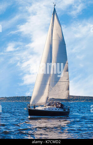 Sailing on a sunny day in the Pacific Northwest - Stock Photo