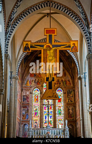 Giotto's Crucifix in Santa Maria Novella church in Florence Italy - Stock Photo