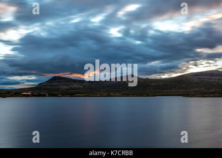 A quiet Norwegian lake at sunset in the Rondane National Park in Norway - 1 - Stock Photo