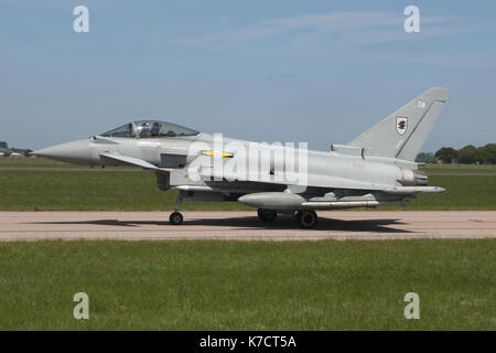 Armed Quick Reaction Alert Eurofighter Typhoon from 11 Squadron, RAF taxiing back to it's shelter at Coningsby after - Stock Photo