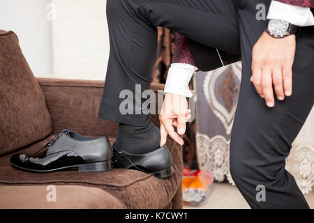 Groom in his weeding day in preparation - Stock Photo