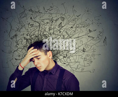 Thoughtful stressed man with a mess in his head - Stock Photo