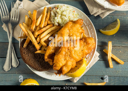 Homemade Beer Battered Fish Fry with Coleslaw and Chips - Stock Photo