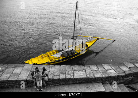 The rabelo boat is a Portuguese vessel of the Douro River used to bring port wine barrels from alto Douro river - Stock Photo
